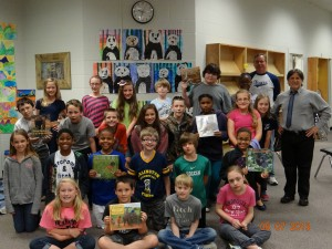 Pictured is Mr. Stanko's 5th grade class with Mr. Stanko and the 2013 visiting author Richard Sobol.   Photo Courtesy of AES
