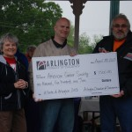 The Arlington Chamber of Commerce presented a check for $1500 raised at A Taste of Arlington.  From left, Chamber Board Member Claudia Horton, A Taste of Arlington Event Chair Mark Louderback, and Relay 38002 Co-Chair Gerald McGee