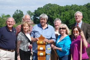 Owner Jim Wilson (center) shows off a handcrafted wine holder presented in honor of the groundbreaking on May 13 for Delta Blues Winery Also pictured (from left): Lakeland Mayor Scott Carmichael, Commissioner Jerry Mickie, Vice-Mayor Cecil Tompkins, owners Sheila Zaricor-Wilson, and Dianne Day, Shelby County Mayor Mark Luttrell.