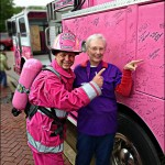 "A Survivor proudly points to her name on ""Ida Mildred"", the Pink Heals Memphis Fire Truck as a ""Guardian of the Ribbon"" shows his support for her victory.  Photo By Jeremy Elkins"