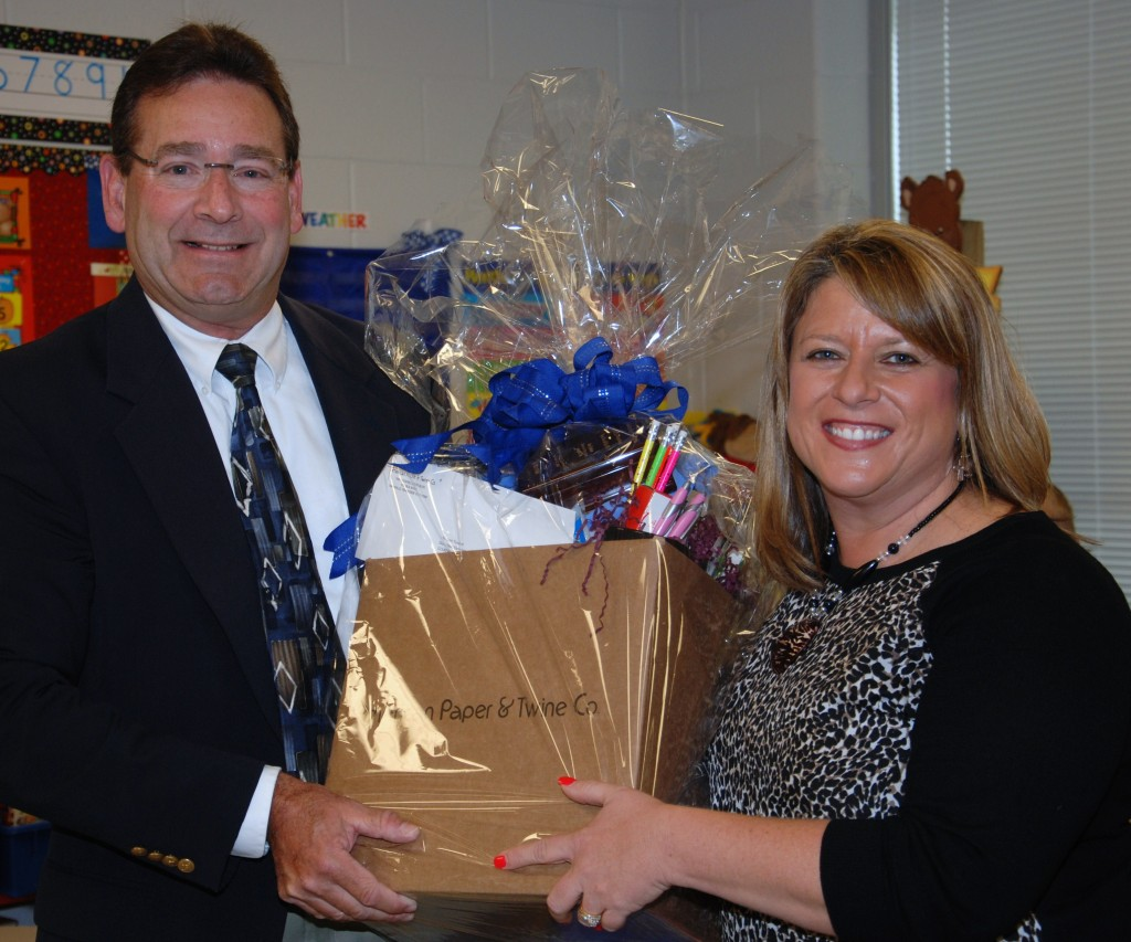 Rick Eiseman, American Paper & Twine, presents Lori Tooker with a gift basket
