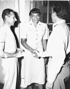 PFC Annie Laurie Grimes (Center) of Arlington, Tennessee, is introduced to Mr. Thad R. Kelly, (right) her supervisor, by Mr. William T. Sanner, as she reports to the Supply Department, Headquarters, Marine Corps, 1950. Official U.S. Marine Corps Photo 314187